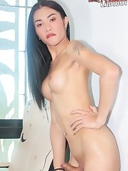 Watch as busty amateur ladyboy Lisa gets naked and plays with her cock!